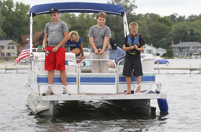 Candace H. Johnson-For Shaw Media Michael Bowes, 12, Max Morenzoni, 13, both of Wauconda and Matthew Kala, 11, of Oswego fish off of a boat during the 13th Annual Kids Fishing Derby in Bangs Lake in Wauconda. The event was hosted by Wauconda Boat and sponsored by the Bangs Lake Advisory Committee. (9/2/18)