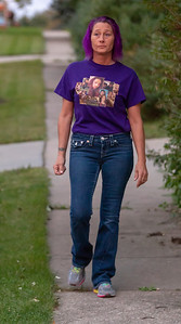 Tammy Searcy walks outside her McHenry home Saturday, September 8, 2018. One year ago, her son, Michael Roach, was buried.  KKoontz – For Shaw Media