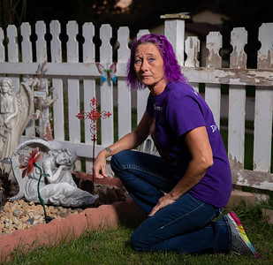 Tammy Searcy kneels by her memory garden at her home in McHenry Saturday, September 8, 2018. One year ago, her son, Michael Roach, was buried.  KKoontz – For Shaw Media