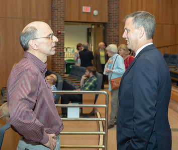 Democrat candidate for the 6th Congressional district, Sean Casten (right) talks with Jim Daleo from Crystal Lake Monday, September 10, 2018 at a candidate meet and greet held by the League of Women Voters at McHenry County College in Crystal Lake.  KKoontz – For Shaw Media