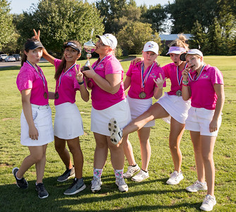 The ladies from the Crystal Lake Central Co-op golf team celebrate another team victory Tuesday, September 11, 2018 at the McHenry County Girls Golf Tournament held at the Boone Creek Golf Club in Bull Valley, IL.  KKoontz – For Shaw Media