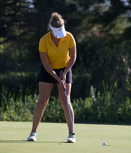 Roslyn Leitner, representing Jacobs High School, sinks her putt at the McHenry County Girls Golf Tournament at the Boone Creek Golf Club in Bull Valley on September 11, 2018. Roslyn finished with a score of 42.  Ken Koontz for Shaw Media
