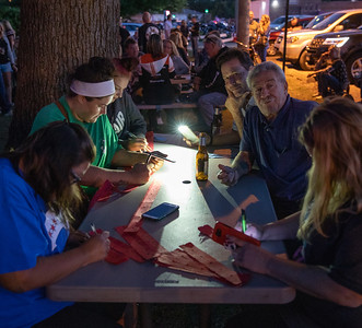 As daylight hours grow shorter, area residents resort to flashlight apps to fill out raffle tickets Tuesday, September 11, 2018 at the Queen of Hearts drawing held at the VFW in McHenry. KKoontz – For Shaw Media