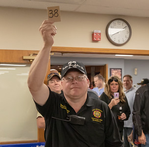 McHenry Veterans of Foreign Wars Post 4600 Cmdr. Dwane Lungren brings in envelope number 38 to be opened at the Queen of Hearts raffle Tuesday, September 11, 2018 in McHenry. The card in the envelope was the ten of spades forcing a draw-down to the raffle next Tuesday night. KKoontz – For Shaw Media