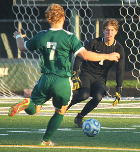 Candace H. Johnson-For Shaw Media Carmel's Camden Krautsack stops a shot on goal by Grayslake Central's Peder Harvey (#7) in the first half at Grayslake Central High School. Carmel won 4-0. (9/11/18)