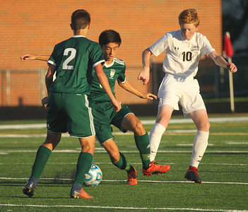 Candace H. Johnson-For Shaw Media Grayslake Central's Thomas Ramsey and Owen Aaberg keep the ball away from Carmel's Ryan Long in the first half at Grayslake Central High School. Carmel won 4-0. (9/11/18)