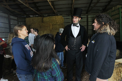 Candace H. Johnson-For Shaw Media Tracy Balla, of Grayslake, an AP U.S.history teacher with Round Lake High School, and her students Nadia McPherson, 17, and Jayda Delatorre, 16, both of Round Lake Beach talk with President Abraham Lincoln (Kevin J. Wood) in a barn during Hainesville's Civil War Encampment & Battle at the Northbrook Sports Club on Hainesville Road. (9/9/18)