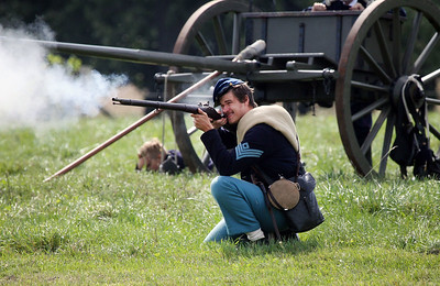 Candace H. Johnson-For Shaw Media Ryan Schuda, of Lemont, portrays a Union soldier with the 45th Illinois Infantry, shoots a rifled musket in a battle against the Confederates during Hainesville's Civil War Encampment & Battle at the Northbrook Sports Club on Hainesville Road. (9/9/18)