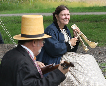 Candace H. Johnson-For Shaw Media Elaine Masciale, of Palatine (on the right) plays 19th Century music on a jawbone with her husband, John, on the banjo, as they portray Mr. & Mrs. Bryant with the Tin Cremona band during Hainesville's Civil War Encampment & Battle at the Northbrook Sports Club on Hainesville Road. The jawbone was a found instrument used to make music during the time of the Civil War.(9/9/18)