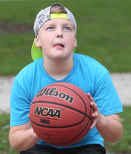 Candace H. Johnson-For Shaw Media Nick Green, 9, of Gurnee competes in the free throw contest during the Gurnee Park District's 50th Anniversary Celebration at Viking Park in Gurnee. (9/8/18)