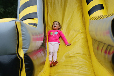 Candace H. Johnson-For Shaw Media Kinsley Knighton, 5, of Antioch goes down the slide of an inflatable obstacle course during the Gurnee Park District's 50th Anniversary Celebration at Viking Park in Gurnee. (9/8/18)