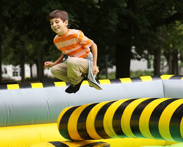 Candace H. Johnson-For Shaw Media Ethan Honey, 10, of Lincolnshire jumps on a Meltdown inflatable during the Gurnee Park District's 50th Anniversary Celebration at Viking Park in Gurnee. (9/8/18)