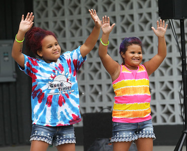 Candace H. Johnson-For Shaw Media McKence Brandon, 10, of Fox Lake and her sister, Haydan, 8, dance to music played by A-Z Entertainment, ltd. during the Gurnee Park District's 50th Anniversary Celebration at Viking Park in Gurnee. (9/8/18)