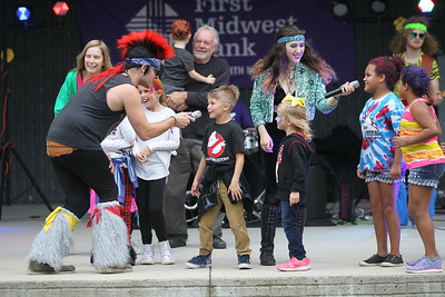 Candace H. Johnson-For Shaw Media The 80's cover band called, The Breakfast Club, get children and adults to sing and dance on stage during the Gurnee Park District's 50th Anniversary Celebration at Viking Park in Gurnee. (9/8/18)
