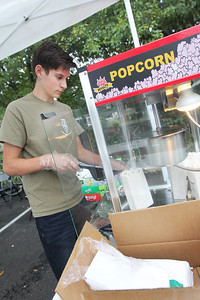 Candace H. Johnson-For Shaw Media Eric Jensen, 15, of Gurnee with Boy Scout Troop #677 makes popcorn to sell during the Gurnee Park District's 50th Anniversary Celebration at Viking Park in Gurnee. Boy Scout Troop #677, out of Gurnee Community Church, is the oldest Boy Scout troop in Illinois.(9/8/18)