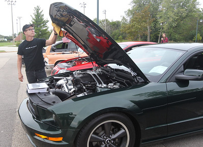 Candace H. Johnson-For Shaw Media Keith Meadors, of Libertyville polishes his 2008 Ford Mustang Bullitt at the car show during the Gurnee Park District's 50th Anniversary Celebration at Viking Park in Gurnee. (9/8/18)