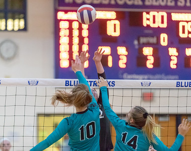 Woodstock's Sophia Wicker gets double-teamed at the net Thursday, September 13, 2018 by Woodstock North defenders at Woodstock High School. Woodstock went on to win the match in two straight sets. KKoontz – For Shaw Media