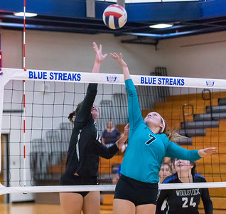 Woodstock's Sophia Wicker (L) and Woodstock North's Emily Eder battle it out at the net Thursday, September 13, 2018 in Woodstock. Woodstock went on to win the match in two straight sets. KKoontz – For Shaw Media