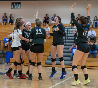 Woodstock players celebrate the two-straight set win over crosstown rival Woodstock North Thursday, September 13, 2018 at Woodstock High School.  KKoontz – For Shaw Media