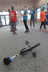Candace H. Johnson-For Shaw Media Jennifer Richard, director, (second from right) works with her Stars Performance Troupe on a routine for an upcoming show in Chicago as one of the unicycles used for the show sits close by at Circus Kazoo in the Movement Arts Space on Atkinson Rd. in Grayslake. (9/18/18)