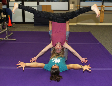 Candace H. Johnson-For Shaw Media Jennifer Richard, of Grayslake, director, works with Silver Gudbrandsen, of Gurnee on doing different acrobatics during an open skills Adult Class at Circus Kazoo in the Movement Arts Space on Atkinson Rd. in Grayslake. (9/18/18)