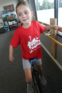 Candace H. Johnson-For Shaw Media Mallory Bernardi, 10, of Grayslake idles in place at the barres with her unicycle as she works on drills during the Unicycle Class at Circus Kazoo in the Movement Arts Space on Atkinson Rd. in Grayslake. The unicycle class was for students of all levels ages 7-13.(9/18/18)