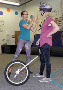 Candace H. Johnson-For Shaw Media Jennifer Richard, director, teaches Silver Gudbrandsen, of Gurnee how to ride a unicycle during an open skills Adult Class at Circus Kazoo in the Movement Arts Space on Atkinson Rd. in Grayslake. (9/18/18)