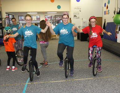 Candace H. Johnson-For Shaw Media Sara Miller, of Grayslake, Kiara Promenzio, of Ingleside, both 12, and Nora Paschos, 13, of Round Lake, all with the Stars Performance Troupe, practice riding their unicycles together at Circus Kazoo in Grayslake.