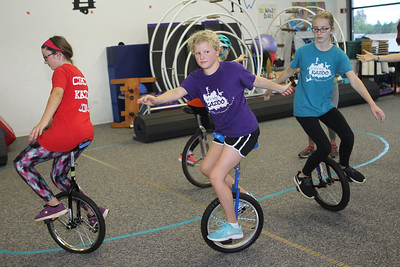 Candace H. Johnson-For Shaw Media Nora Paschos, 13, of Round Lake, Bella Wilgen and Sara Miller, both 12, of Grayslake, all with the Stars Performance Troupe, work on a carousel routine for an upcoming show in Chicago at Circus Kazoo in the Movement Arts Space on Atkinson Rd. in Grayslake. (9/18/18)