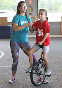 Candace H. Johnson-For Shaw Media Jennifer Richard, director, works on different drills with Mallory Bernardi, 10, of Grayslake as she rides a unicycle in the Unicycle Class at Circus Kazoo in Grayslake. The unicycle class is for all levels, ages 7-13.