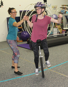 Candace H. Johnson-For Shaw Media Jennifer Richard, of Grayslake, director, works with Silver Gudbrandsen, of Gurnee on a figure eight and directional turning while riding a unicycle during an open skills Adult Class at Circus Kazoo in Grayslake.