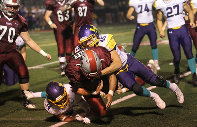 Candace H. Johnson-For Shaw Media Wauconda's Kellen Calby and Colin Westfall tackle Antioch's Nicholas Wiley as he makes a touchdown in the third quarter at Antioch Community High School. Antioch won 49-13. (9/14/18)