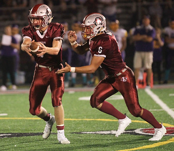 Candace H. Johnson-For Shaw Media Antioch's quarterback Athan Kaliakmanis hands off the ball to Nicholas Wiley against Wauconda in the fourth quarter at Antioch Community High School. Antioch won 49-13. (9/14/18)
