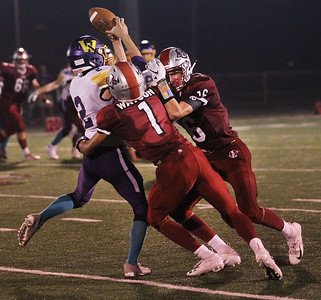 Candace H. Johnson-For Shaw Media Wauconda's Nick Rinchiuso makes the catch as he is tackled by Antioch's TreShawn Watson and Kevin Tebbe in the third quarter at Antioch Community High School. Antioch won 49-13. (9/14/18)