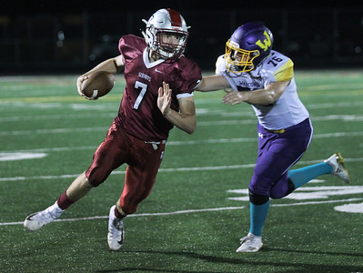 Candace H. Johnson-For Shaw Media Antioch's Athan Kaliakmanis looks to get around the tackle attempt by Wauconda's Alec Smith in the second quarter at Antioch Community High School. Antioch won 49-13. (9/14/18)