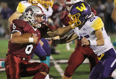 Candace H. Johnson-For Shaw Media Antioch's Nicholas Wiley tries to stop a tackle attempt by Wauconda's Jake Lehmann in the third quarter at Antioch Community High School. Antioch won 49-13. (9/14/18)