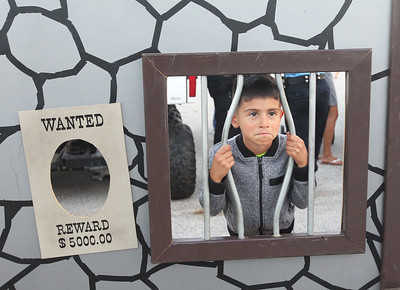 Candace H. Johnson-For Shaw Media Ethan Boyer, 6, of Waukegan reacts to being in a make believe jail during Touch-A-Truck at the Hunt Club Park Community Center in Gurnee. (9/14/18)