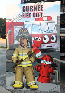 Candace H. Johnson-For Shaw Media Zeclan Lehnert, 3, of Round Lake Beach has fun getting his picture taken in a Gurnee Fire Dept. cutout during Touch-A-Truck at the Hunt Club Park Community Center in Gurnee. (9/14/18)