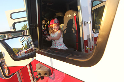 Candace H. Johnson-For Shaw Media Mikayla Tolemy, 4, of Mundelein sits in a Gurnee Fire Dept. fire truck during Touch-A-Truck at the Hunt Club Park Community Center in Gurnee. (9/14/18)