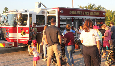 Candace H. Johnson-For Shaw Media Visitors take a look at a Gurnee Fire Dept. fire truck during Touch-A-Truck at the Hunt Club Park Community Center in Gurnee. (9/14/18)