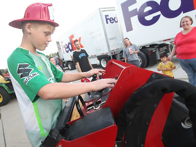 Candace H. Johnson-For Shaw Media Jonathan Credille, 10, of Waukegan checks out a Toro Dingo wide track vertical lift owned by the Gurnee Park District during Touch-A-Truck at the Hunt Club Park Community Center in Gurnee. (9/14/18)