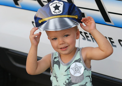 Candace H. Johnson-For Shaw Media Robert Fisher, 2, of Kenosha, Wis., adjusts his Vernon Hills police officer's hat during Touch-A-Truck at the Hunt Club Park Community Center in Gurnee. (9/14/18)