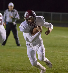 Marengo quarterback Travis Knaak keeps the ball and runs it in from the second-yard line to tie the score at seven with 2:16 left in the second quarter against Richmond-Burton Friday, September 21, 2018 in Richmond. Marengo went on to take the win 14-13. KKoontz – For Shaw Media