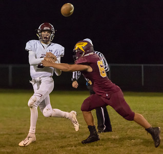 Marengo quarterback Travis avoids the defensive rush and gets a pass off against Richmond-Burton Friday, September 21, 2018 in Richmond. Marengo went on to take the win 14-13. KKoontz – For Shaw Media