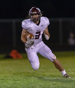 Marengo running back Finn Schirmer makes an open field cut against Richmond-Burton Friday, September 21, 2018 in Richmond. Marengo pulls off the victory 14-13. KKoontz – For Shaw Media