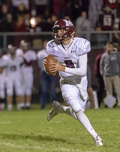 Marengo quarterback Travis Knaak rolls out of the pocket against Richmond-Burton Friday, September 21, 2018 in Richmond. Marengo went on to take the win 14-13. KKoontz – For Shaw Media