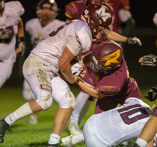 Marengo's Blake Heinberg strips the ball from Richmond Burton's Logan Hutson for the turnover Friday, September 21, 2018 in Richmond. Marengo went on to win a close one 14-13. KKoontz – For Shaw Media