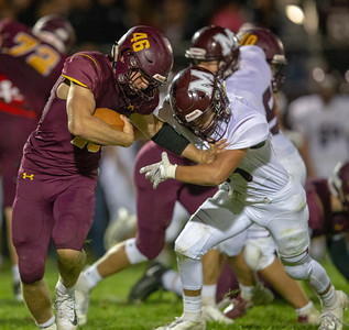 Richmond-Burton running back Michael Kaufman tries to works his way through the Marengo defense Friday, September 21, 2018 in Richmond. Marengo took the victory 14-13. KKoontz – For Shaw Media