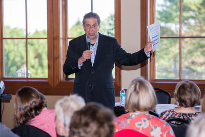 "John ""Bowzer"" Bauman of the band Sha Na Na and head of The Social Security Works Political Action Committee talks with area residents concerning Social Security benefits Thursday, September 26, 2018 at Pinecrest Golf Club in Huntley. The event was held to endorse and show support for 14th congressional District Democratic Candidate Lauren Underwood.  KKoontz – For Shaw Media"