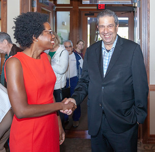 "John ""Bowzer"" Bauman of the band Sha Na Na and head of The Social Security Works Political Action Committee shakes hands with 14th congressional District Democratic Candidate Lauren Underwood Thursday, September 26, 2018 at Pinecrest Golf Club in Huntley. Bauman was on hand to show support for the candidate.   KKoontz – For Shaw Media"